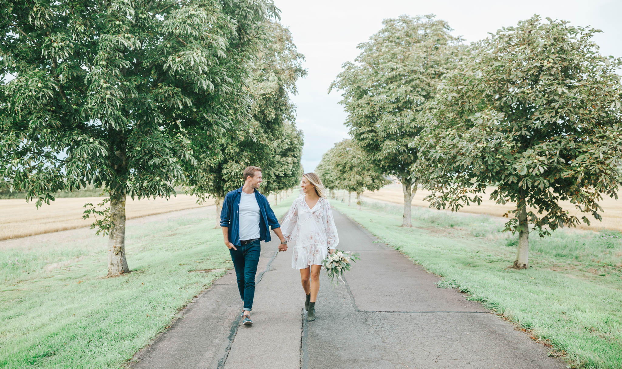 Newly married couple on farm drive at The Gardens at Polehanger